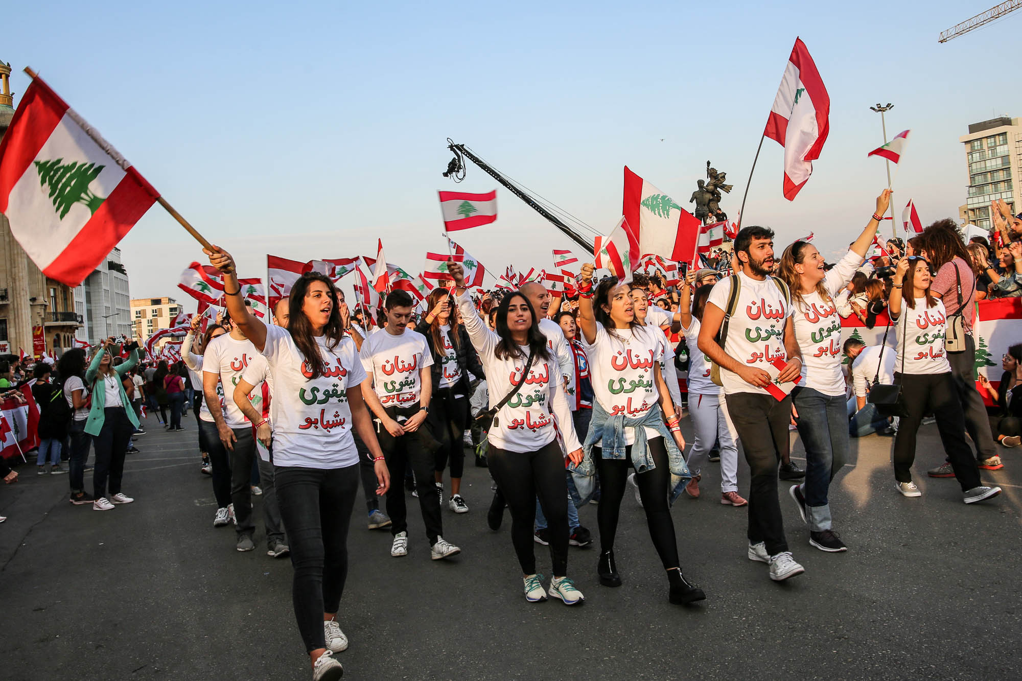 Beirut, Lebanon - November 22, 2019: Lebanese marching for Lebanon's Independence Day in a Civil Parade while protesting against the current government and corruption in the country. Editorial credit: Hiba Al Kallas / Shutterstock.com.