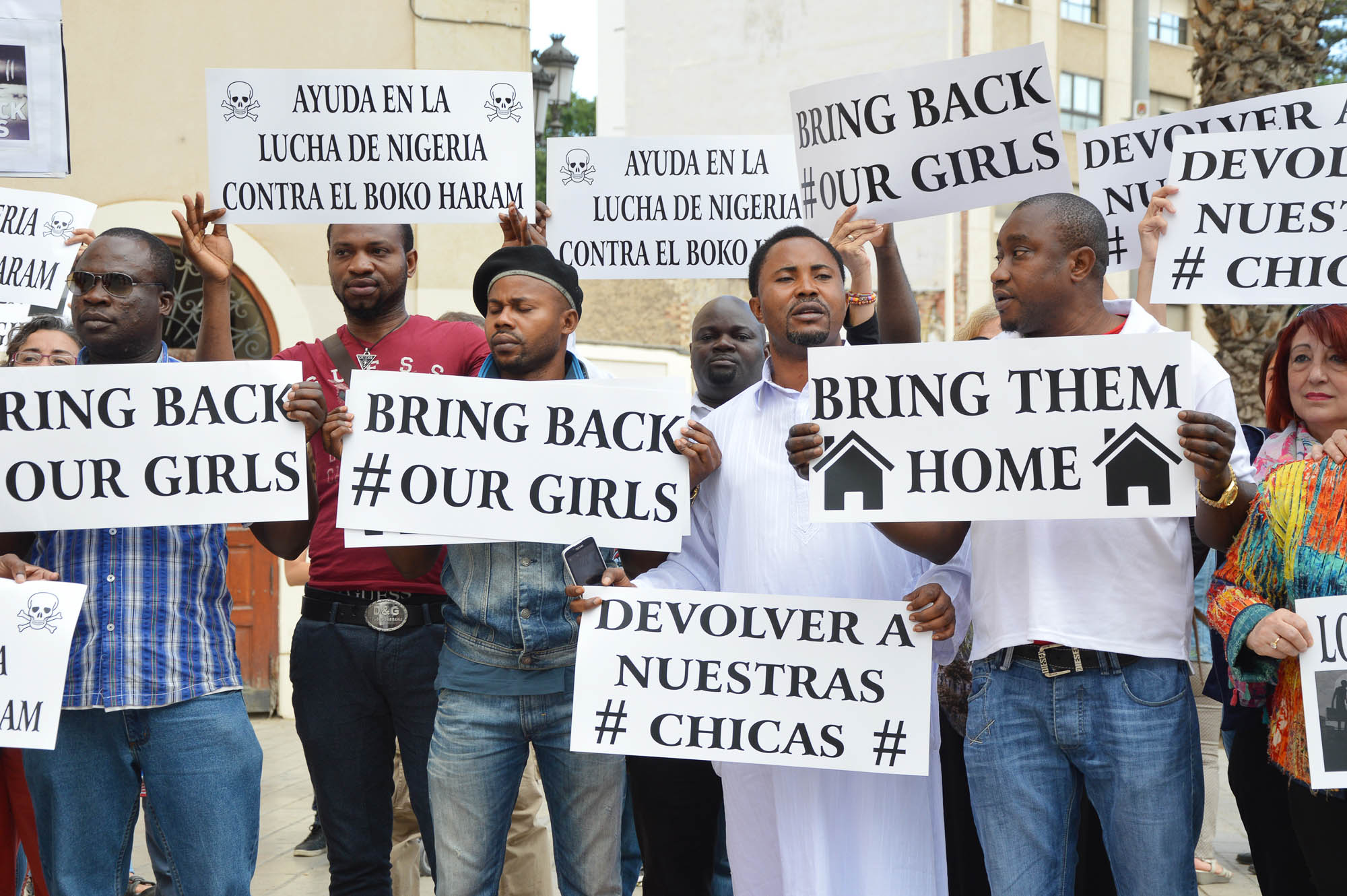 Association of Nigerians protest with locals against Boko Haram actions that claimed responsibility for abducting over 200 girls from a school in Chibok, Nigeria. Spain, 2014. Editorial credit: rSnapshotPhotos / Shutterstock.com.