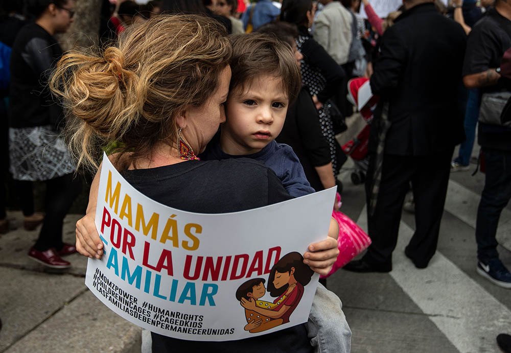 People take part in a protest against US immigration policies outside the US embassy in MExico City