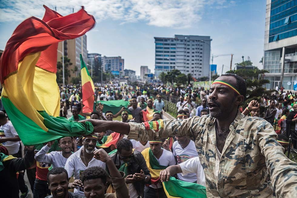Ethiopians wave national flags and celebrate in the streets of Addis Ababa the return of Berhanu Nega, the leader of the former armed movement Ginbot 7, after 11 years in exile, on September 9, 2018. Credit: YONAS TADESSE/AFP/Getty Images.