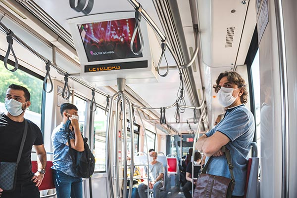 Turkey pandemic tramway train car people wear masks