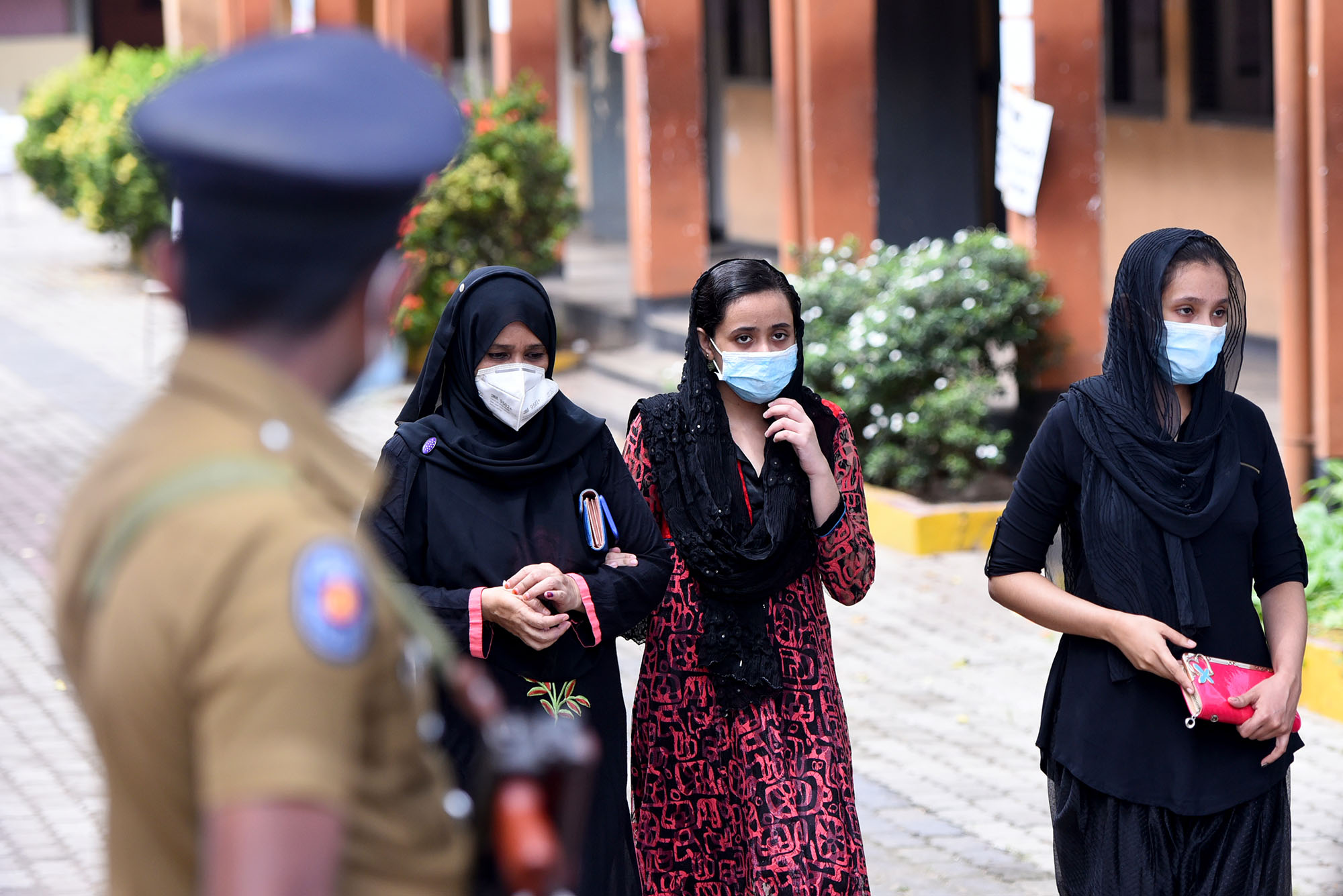 Three women arrive at a polling station preparing to cast their votes during the parliamentary election in Colombo, Sri Lanka, on August 5, 2020. Credit: Ruwan Walpola/Shutterstock.com.