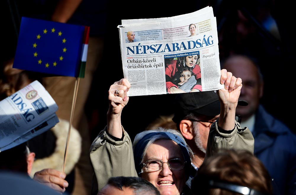 Journalists of Hungary's biggest opposition newspaper <em>Nepszabadsag</em> and their supporters protest in Budapest.