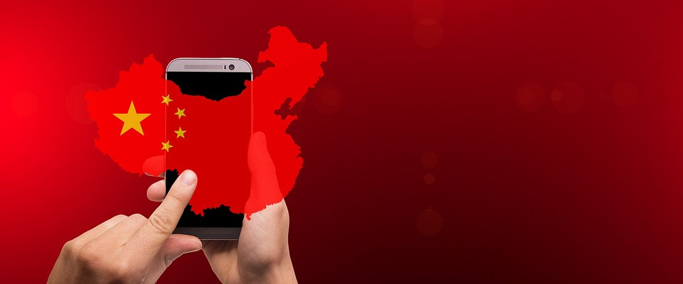 Map of China over a cell phone