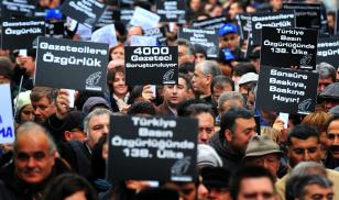 Turkish journalists hold placards against censorship during a protest on Istiklal Avenue in Istanbul, on March 4, 2011. Credit: MUSTAFA OZER/AFP via Getty Images.