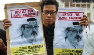Humanitarian activists hold a poster with a picture of Jamal Khashoggi, a journalist who was killed in Turkey. Makassar, Indonesia. 18 October 2018. Editorial credit: Herwin Bahar / Shutterstock.com