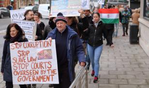 Hungarian people living in the English city marched silently through the streets in a show of solidarity with protesters in Hungary.  Bristol, England. 16 December 2018. Editorial credit: tviolet / Shutterstock.com