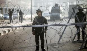 Egyptian riot policemen standing guard outside the Police Academy in Cairo, February 2014. AFP/Getty Images.
