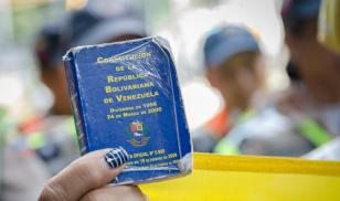 Detail of a copy of the Constitution of Venezuela. In the hands of a demonstrator against the government of Nicolás Maduro.  Venezuela.  Decmeber 2016. Editorial credit:  StringerAL / Shutterstock.com