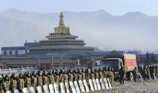 Chinese soldiers amass outside of Labrang Monastery in Gansu Province to prevent protests during Losar, the Tibetan lunar New Year festival, in February 2016 (Christophe Boisvieux/Getty Images)