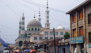 "A Hui mosque in Linxia, Gansu Province, also known as ""Little Mecca,"" where restrictions on Islam are more lax than in Xinjiang. Credit: Wikimedia"