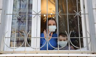 Russia Moscow coronavirus mom and child look out of window