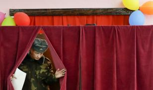 A soldier in Belarus casts his ballot in elections