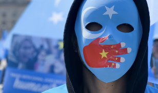 A demonstrator at a protest against China's human rights abuses against Uyghur Muslims. Credit: Anadolu Agency/Getty Images