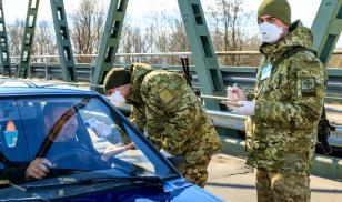Police in Ukraine at a COVID checkpoint