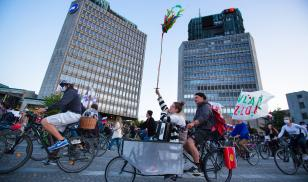 Protesters ride bicycles through the streets of Ljubljana during an anti-government protest in May 2020 amid the COVID-19 pandemic. (Image credit:  Luka Dakskobler/SOPA Images/Shutterstock)