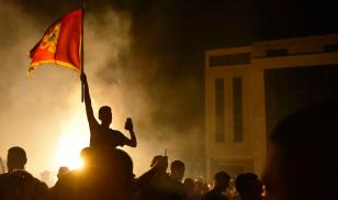 Supporters of opposition groups celebrate after polls close in Montenegro's August 2020 parliamentary elections. (Image credit: Risto Bozovic/AP/Shutterstock)