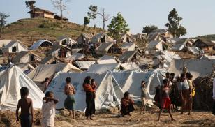 Dozens of makeshift tents surrounded by women and children