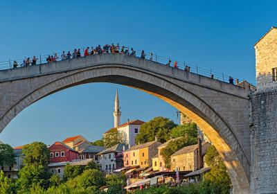 People in Mostar, Bosnia Herzegovina. Editorial credit: Botond Horvath / Shutterstock.com