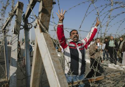 Egyptian man yells in protest at demonstration outside of during a small protest prior to the planned trial of deposed Egyptian President Mohammed Morsi at the Cairo Police Academy on January 8, 2014 in Cairo, Egypt