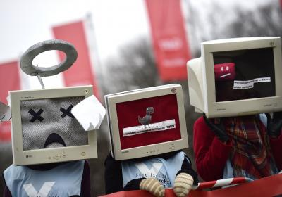 Protesters gather to demonstrate against internet censorship in China, one of the partner countries of the CeBit computer trade fair held in Hanover, Germany (March 2015). Cover image by Alexander Koerner/Getty Images