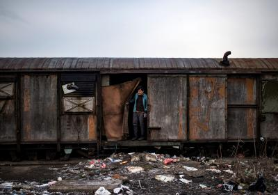 A migrant stands inside an abandoned train wagon used as a makeshift shelter near the main rail station in Belgrade, Serbia. Andrej Isakovic, AFP/Getty Images