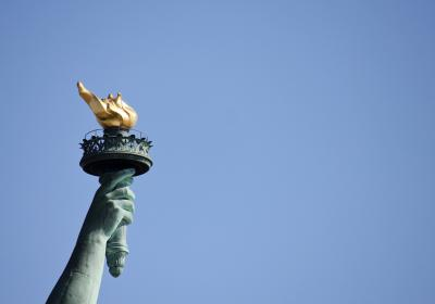 Statute of liberty torch and flame freedom house
