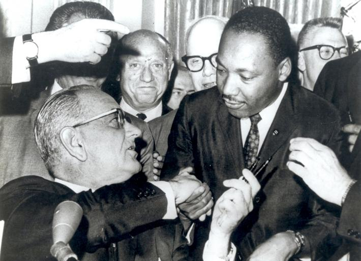 MLK and LBJ shake hands